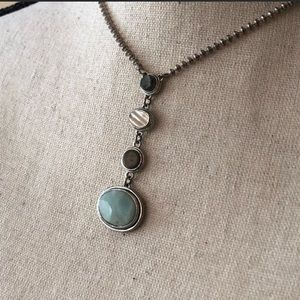 Kenneth Cole 4-stone necklace set in silver.